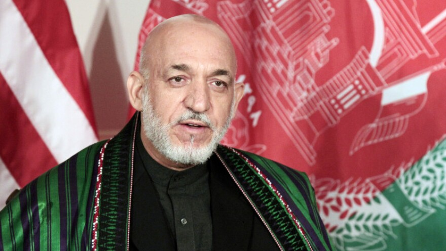 <p>Afghan officials said the six people arrested in connection with a plot to assassinate Afghan President Hamid Karzai included one of Karzai's bodyguards as well as three college students and a university professor. </p>
