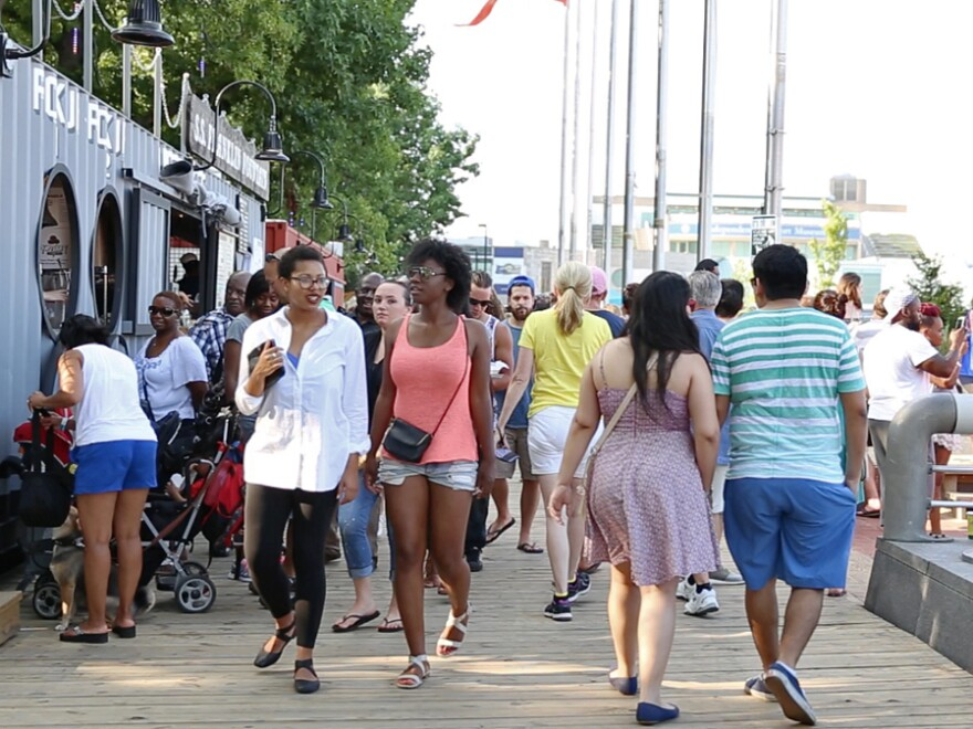 The boardwalk at Spruce Street Harbor Park is one of many attractions drawing visitors along the Delaware River waterfront in Philadelphia.