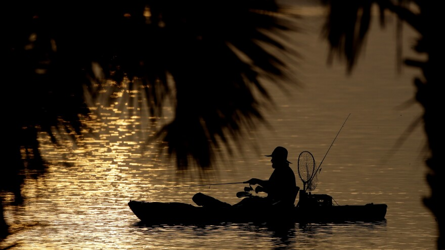 A man fishes in the Indian River Lagoon at sunrise Saturday, May 30, 2020, at Titusville.