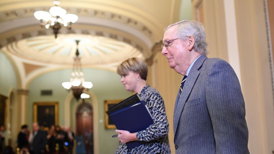 Senate Majority Leader Mitch McConnell walks back to the Senate chamber after a break for the closing arguments in the impeachment trial of President Trump on Monday.