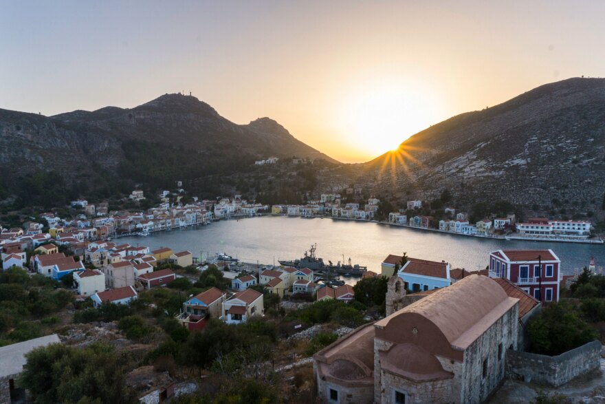 The Greek island of Kastellorizo, shown here at sunset from the top of an ancient castle, is a little over a mile away from the Turkish shore. Known for its architecture, turquoise sea and friendship with the neighbor Turks, it's recently become a pawn in a geopolitical dispute between the Greek and Turkish governments over hydrocarbons and maritime borders.