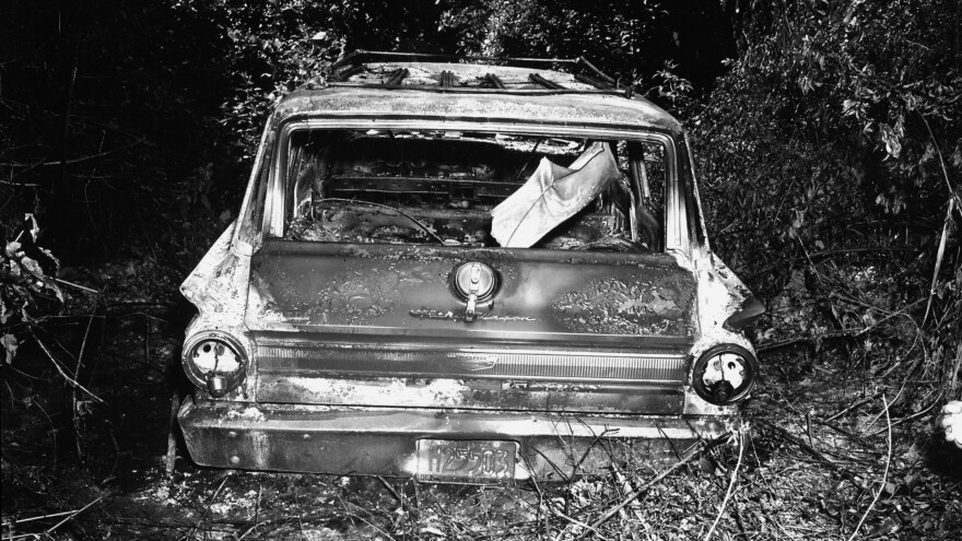 In this picture released by the FBI and the State of Mississippi Attorney General's Office, the burned-out station wagon that slain civil rights workers James Chaney, Andrew Goodman and Michael Schwerner were driving in is seen in June 1964 in the Bogue Chitto swamp, some 13 miles northeast of Philadelphia, Miss.