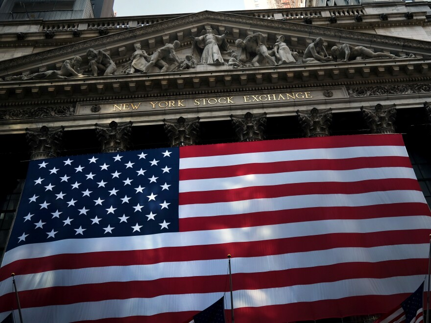 The American flag hangs in front of the New York Stock Exchange on September 21, 2020, in New York City. Citigroup estimates the U.S. economy lost $16 trillion over the past 20 years as a result of discrimination against African Americans.