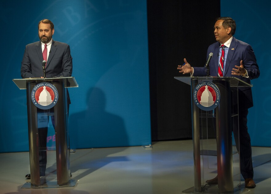 Photo of the candiates speaking on stage