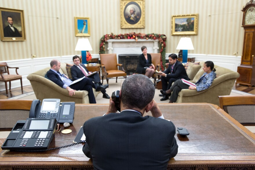 President Obama speaks with President Raul Castro of Cuba from the Oval Office on Tuesday. A day later, both men announced plans to normalize relations between the Cold War-era foes.
