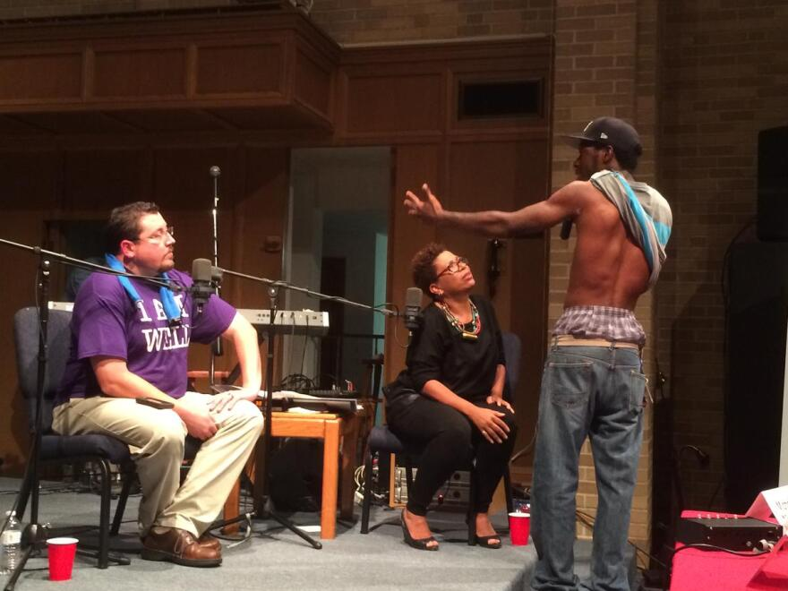 An audience member shows Ferguson Mayor James Knowles III a rubber bullet wound that he says he received during unrest in the north St. Louis County city. A forum sponsored by St. Louis Public Radio became heated, with ire being directed at Knowles.