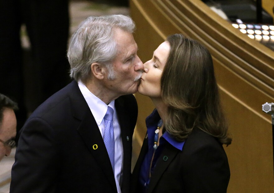 Oregon Gov. John Kitzhaber kisses fiancee, Cylvia Hayes, after he is sworn in for an unprecedented fourth term as governor in Salem, Ore., in January.