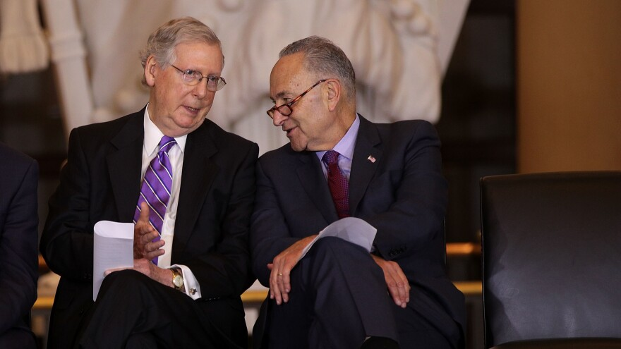 U.S. Senate Majority Leader Mitch McConnell (left) chats with Senate Minority Leader Chuck Schumer in October. The two negotiated a budget agreement that marks a major breakthrough for a Congress still reeling from a partial government shutdown last month.