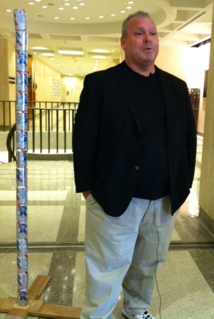 Chaz Stevens and his Festivus beer can pole meet with reporters in the Capitol.