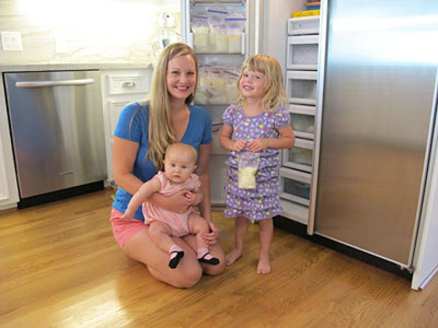 Ashley Beecher, 29, and her daughters Annie (on lap) and Charlie. After feeding Annie, Beecher donates her extra supply to the human milk bank at Texas Children's Hospital.