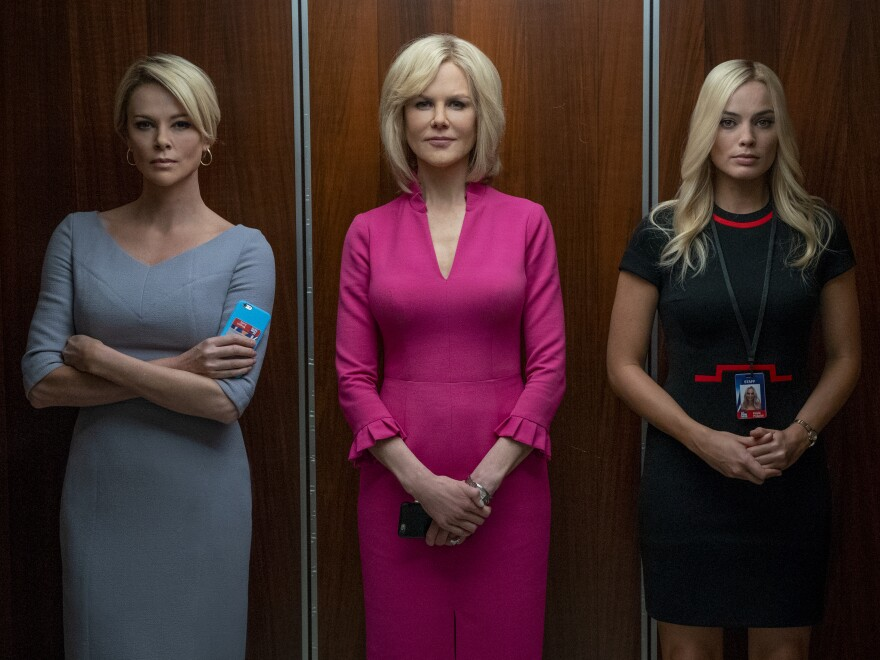 Theron, Nicole Kidman and Margot Robbie play Fox News journalists who bring down network CEO Roger Ailes in <em>Bombshell.</em>