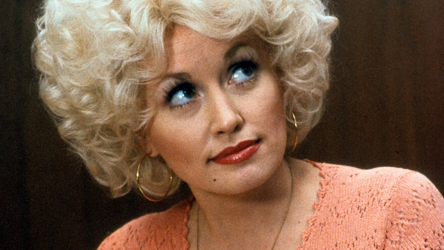 Dolly Parton in a scene from the 1980 comedy <em>9 to 5</em>. The film's theme song, performed by Parton, took on a life of its own.