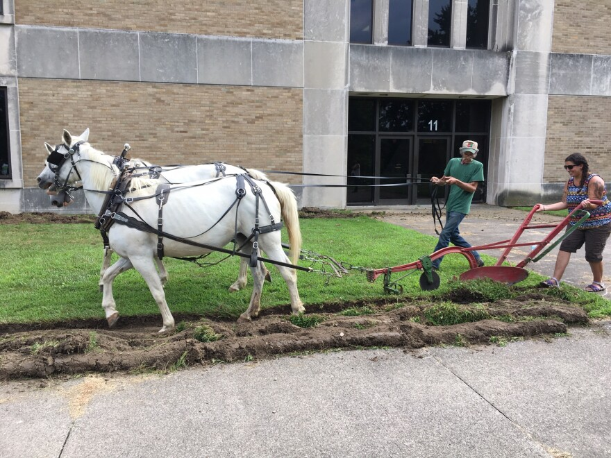 a photo of a horse drawn plough at Akron North High School
