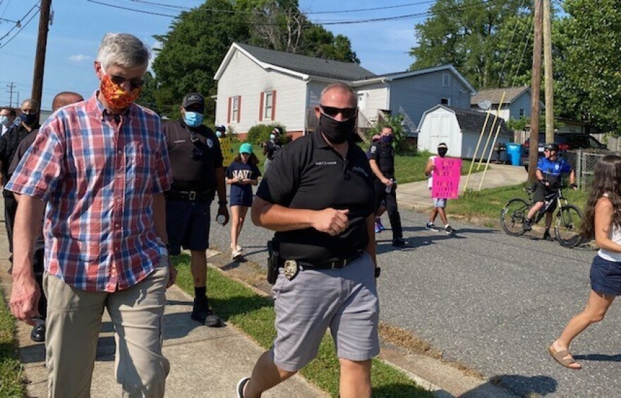 Belmont Police Chief Chad Hawkins, right, joins the march. 6/7/20