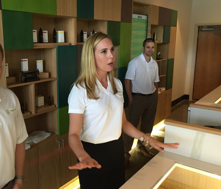 Trulieve CEO Kim Rivers speaking with reporters at the opening of Trulieve's Tallahassee dispensary.
