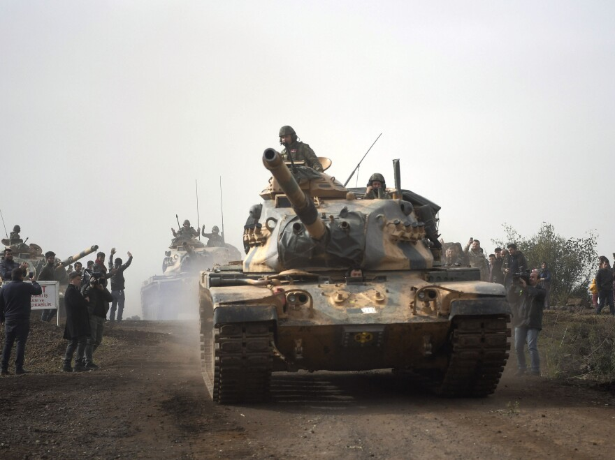 Turkish army tanks head to Afrin, an enclave in northern Syria controlled by U.S.-allied Kurdish fighters, on Monday.