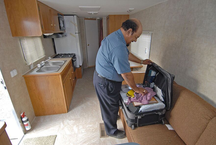 Herbert Jolly moves into a railer provided by the Federal Emergency Management Agency in April 2006.