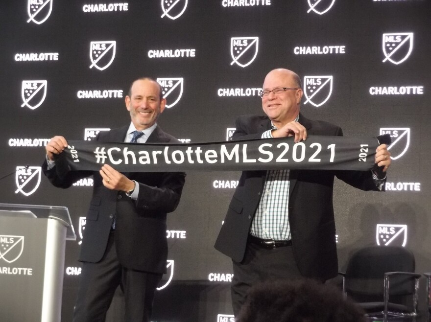 Make that 2022 - Charlotte MLS owner David Tepper (right) and MLS commissioner Don Garber at December's announcement that Charlotte was getting an MLS team.