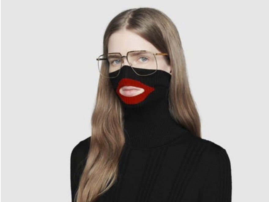 "A screenshot showing Gucci's black turtleneck sweater before the luxury brand pulled it from its online and physical stores. Gucci apologized following complaints the garment resembled ""blackface."""