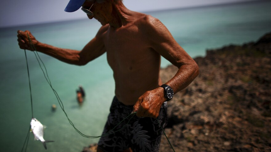 Retired teacher Manuel Landin Rodriguez fishes just off the 18th hole of a golf course in Varadero. He remembers the days before the Cuban Revolution — but does not yearn for them.