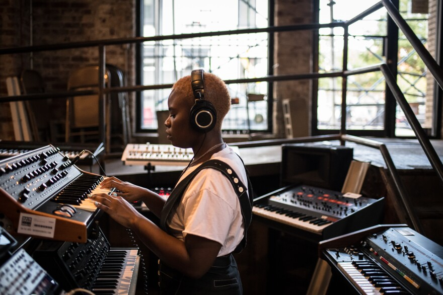 Tamko tries out keyboards at a music shop in Brooklyn. Tamko describes <em>Vagabon</em> as a flex: she plays many of the instruments you hear on it, and she learned the digital audio software Logic Pro so she could produce it almost entirely on her own.