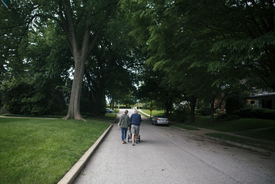 """Greg and Colleen go for a walk with Adeline near Colleen's home in Baltimore. Grandfather and granddaughter interact naturally, with """"a lot of snuggling,"""" Colleen says."""