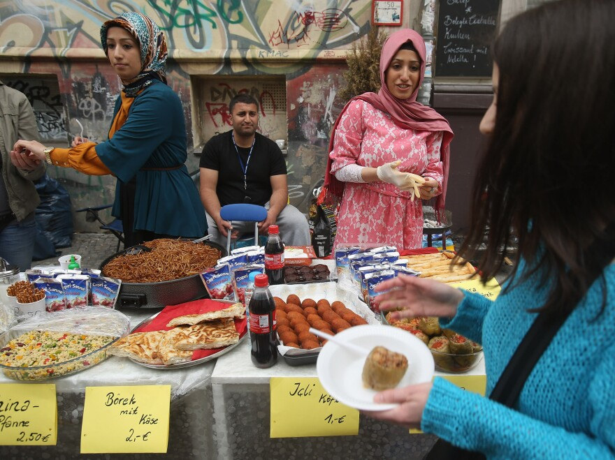 Vendors sell Turkish food in the immigrant-heavy Kreuzberg district in Berlin. A labor deal between Turkey and Germany in 1961 brought a flood of Turks to Germany.