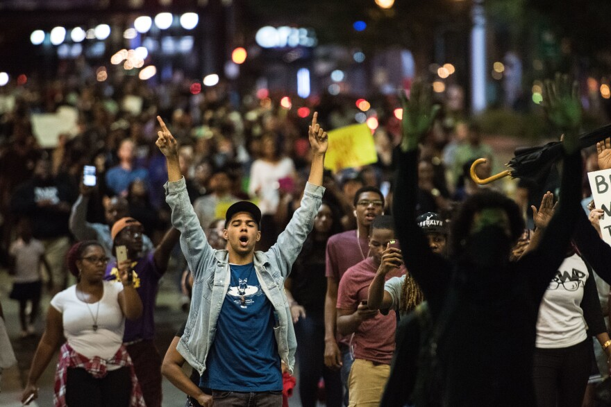 Demonstrators fill a downtown city street during protests on Wednesday night in Charlotte, NC. The protests began the previous night following the fatal shooting of 43-year-old Keith Lamont Scott at an apartment complex near UNC Charlotte.