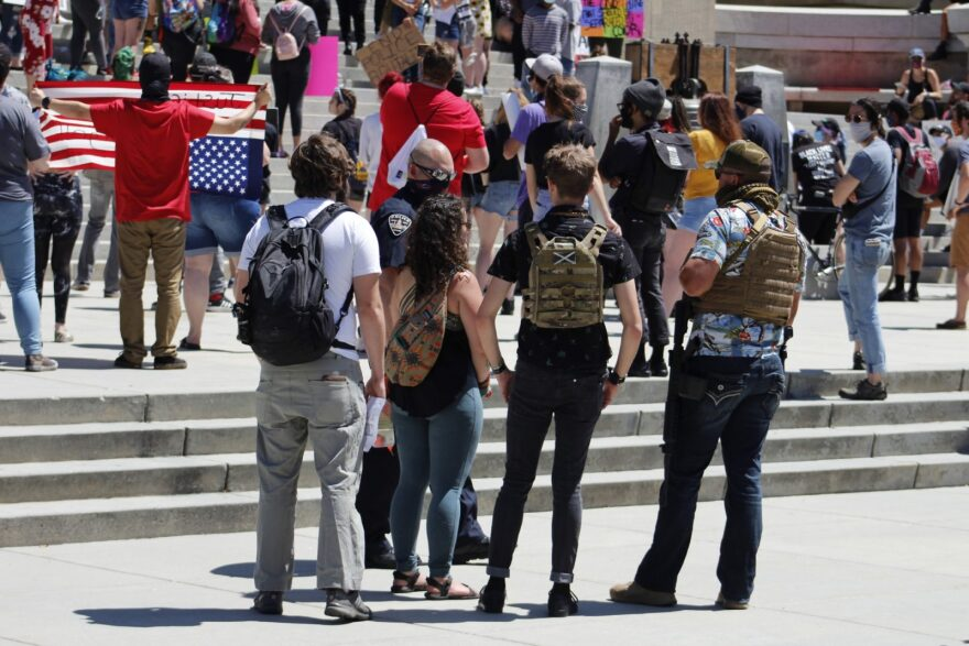 An armed counterprotester stands with others at a Black Lives Matter rally in Boise, Idaho, on May 31.