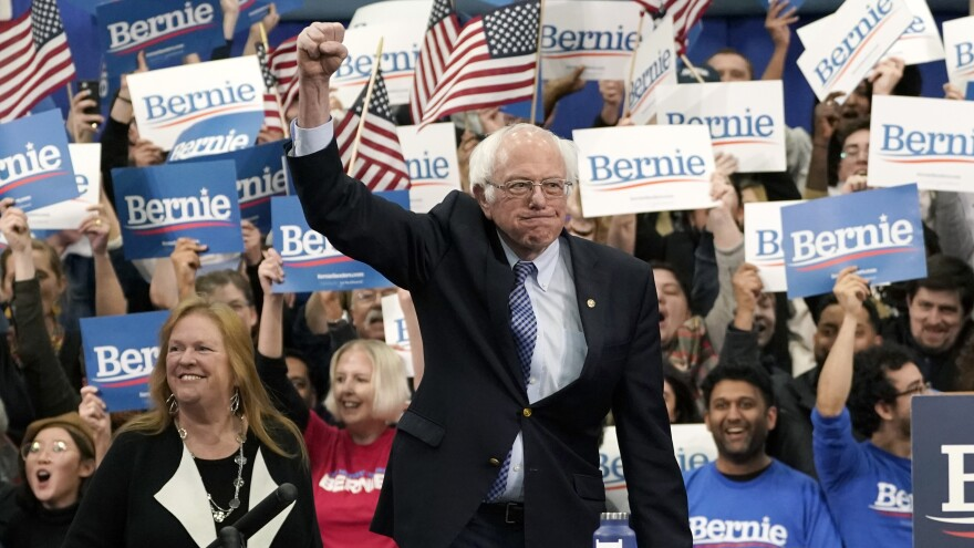Sen. Bernie Sanders takes the stage during a primary night event on Tuesday in Manchester, N.H. His victory, projected by The Associated Press, comes in another close race with Pete Buttigieg.