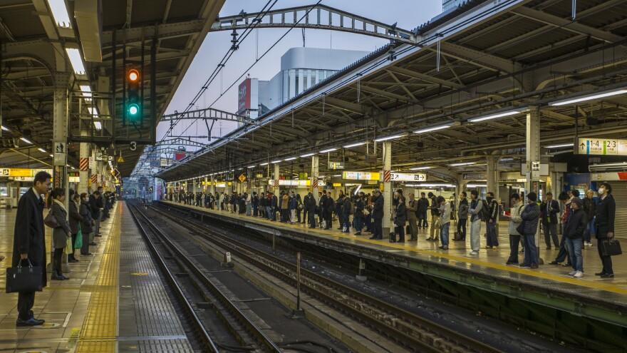 A Japanese train company says it has spoken to a crew that left a station without consulting the time.