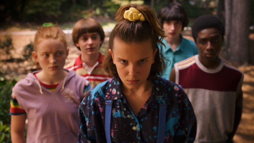 In the 2019 season of <em>Stranger Things</em>, Eleven (portrayed by Millie Bobby Brown<em>) </em>pulls a half-pony with a yellow scrunchie.
