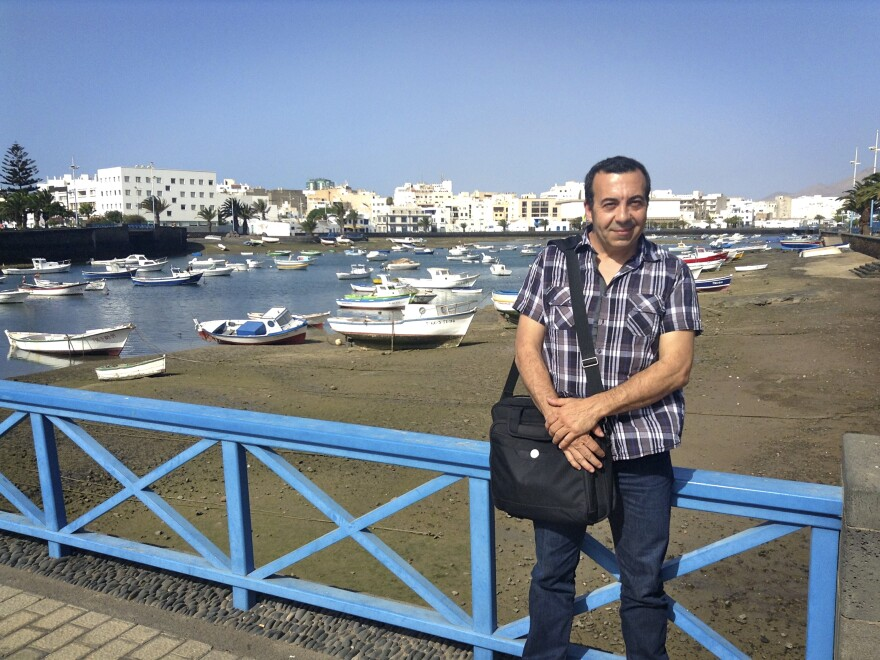 Ezequiel Navio, head of the local government's Office of Global Action, has been lobbying international environmental groups and tour operators to put pressure on Madrid, in hopes of reversing Repsol's work. Here, he is seen in front of a bay in Arrecife, the main town on Lanzarote.