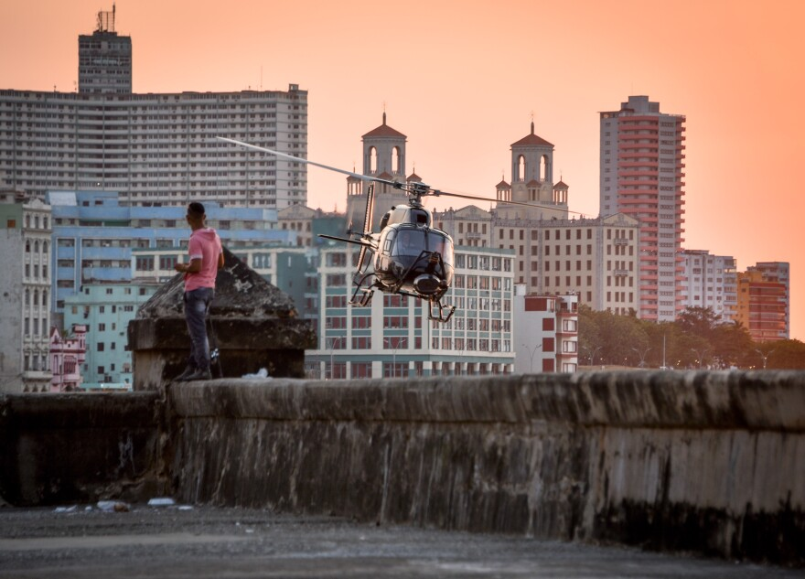 A helicopter used in the shooting of <em>Fast and Furious 8 </em>flies along the waterfront in Havana last week. American filmmakers could not work in Cuba for more than a half century, but a improved relations have opened the doors recently.