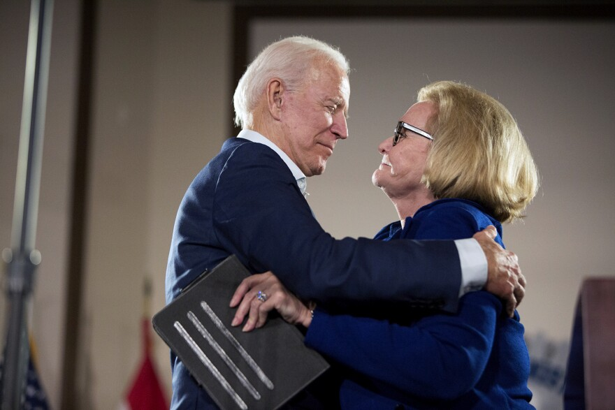Former Vice President Joe Biden greets U.S. Sen. Claire McCaskill on stage at a campaign event Wednesday. Oct. 31, 2018