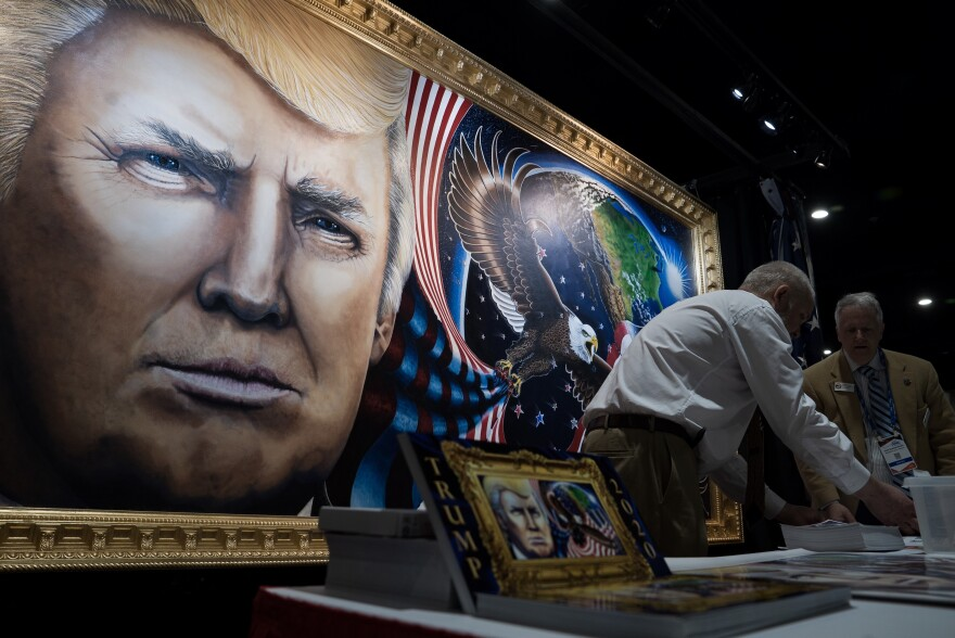 The 8-by-16-foot painting of President Trump by artist Julian Raven is on display at the Conservative Political Action Conference in National Harbor, Md.