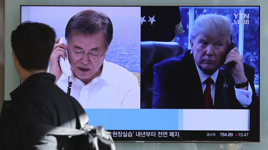 "In December at the Seoul Railway Station in South Korea, a man walks by a TV report about North Korea's missile launch with images of U.S. President Trump and South Korean President Moon Jae-in. On Wednesday, Trump and Moon spoke by phone and Trump expressed openness to U.S.-North Korea talks ""at the appropriate time, under the right circumstances."""