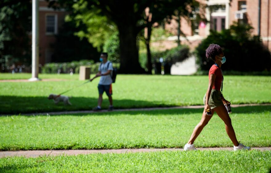 Students walk through the campus of the University of North Carolina at Chapel Hill on August 18. The school halted in-person classes and reverted back to online courses after a rise in the number of COVID-19 cases.