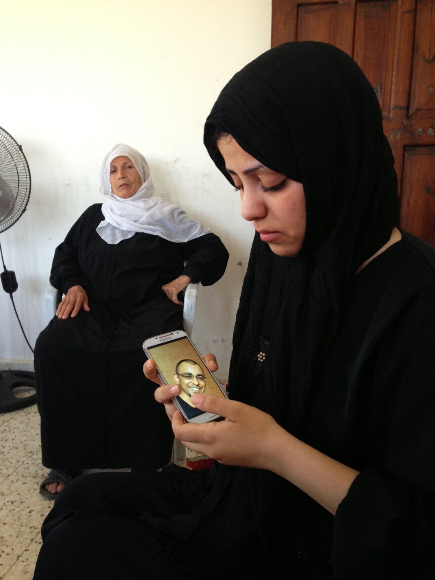 Iman el-Kaas' 33-year-old husband, Anas, was killed last week by an Israeli attack that hit their apartment in the Gaza Strip. She says her husband, a pharmacist, had no ties to Hamas. He is among the nearly 200 killed so far in the current conflict.