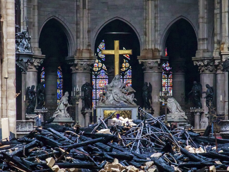Debris are seen inside Notre Dame cathedral in Paris, Tuesday. Firefighters were able to salvage a number of the cathedral's most treasured relics.