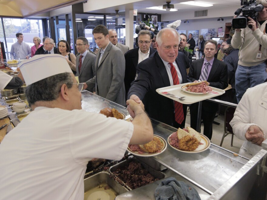 In this file photo taken Nov. 4, 2010 in Chicago, Illinois Gov. Pat Quinn thanks voters at Manny's Deli, two days after the general election in which he defeated Republican challenger Bill Brady.