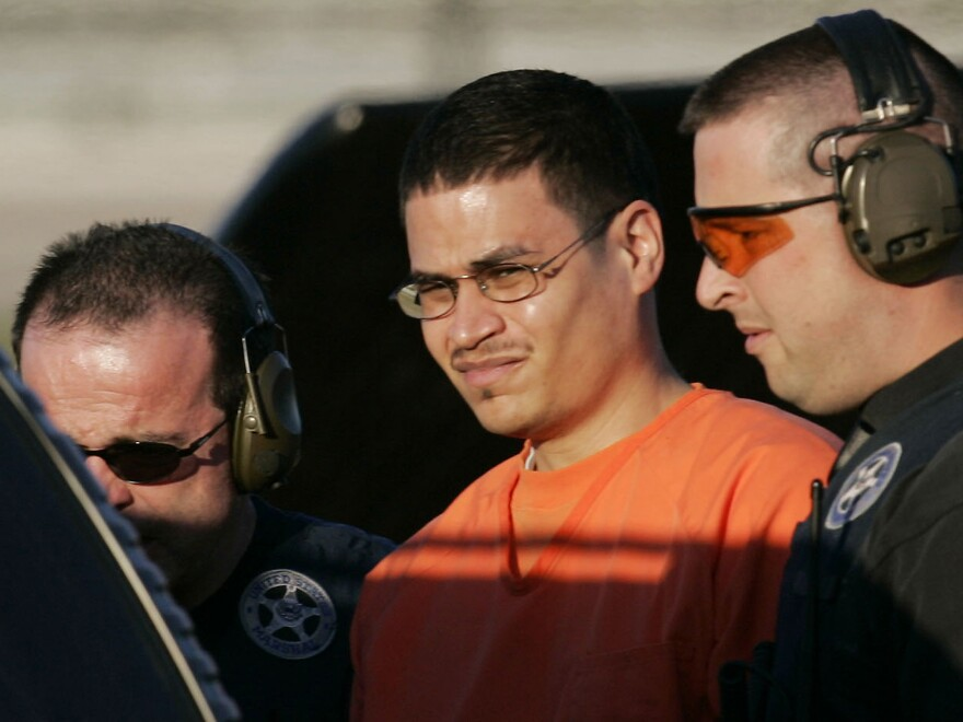 Jose Padilla is escorted by federal marshals near downtown Miami in 2006. Padilla was sentenced a second time by a federal judge on Tuesday, getting an additional four years for terrorism conspiracy charges.
