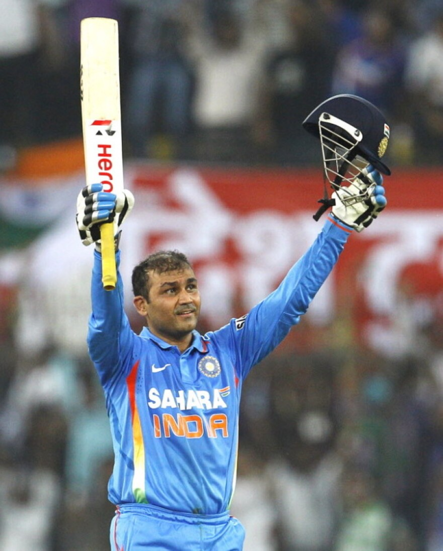 """India's captain Virender Sehwag celebrates his """"double century."""""""