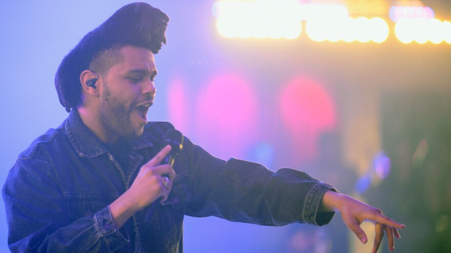 """The Weeknd —€"""" known for his falsetto range —€"""" performs in Las Vegas earlier this year."""