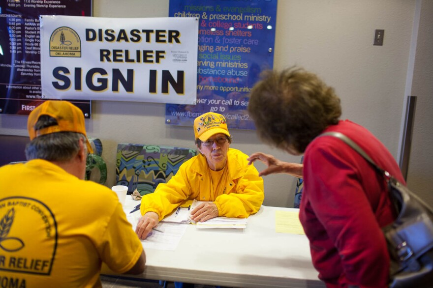 Sue McClure, a volunteer with Disaster Relief of Oklahoma, assists tornado victims Wednesday at the First Baptist Church in Moore, Okla.