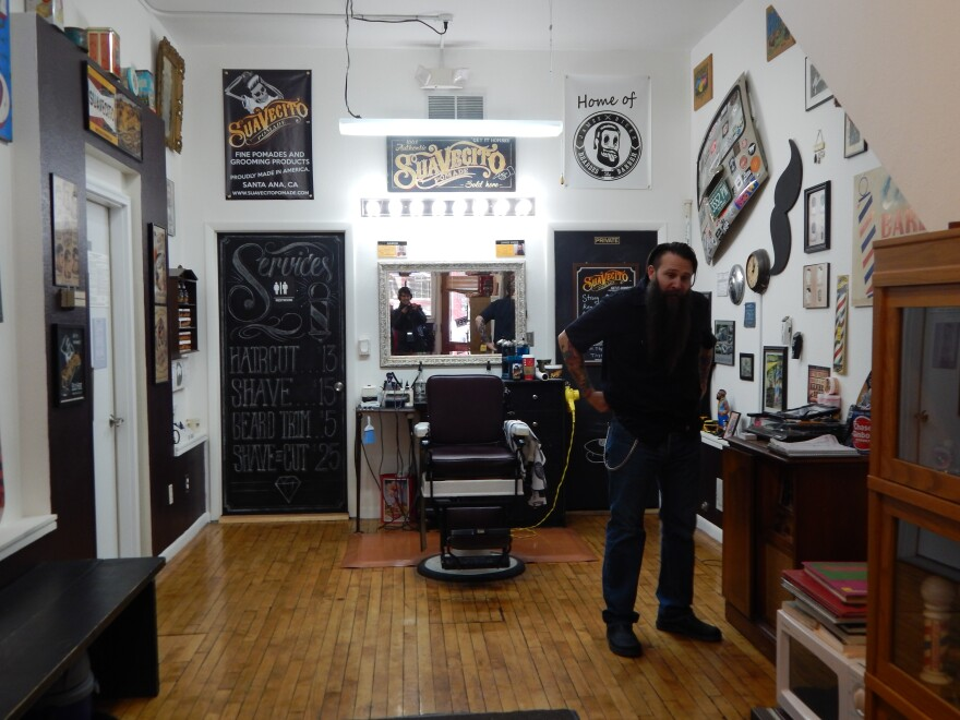 Hicks Barber Shop in the Oregon District. Business has been so good, Hicks hired someone else to come in on his days off.