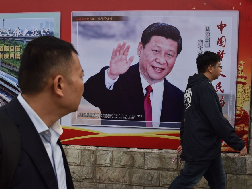 """A poster in Beijing features Chinese President Xi Jinping and a slogan reading """"Chinese Dream, People's Dream."""" Xi is preparing to embark on a second five-year term this week."""