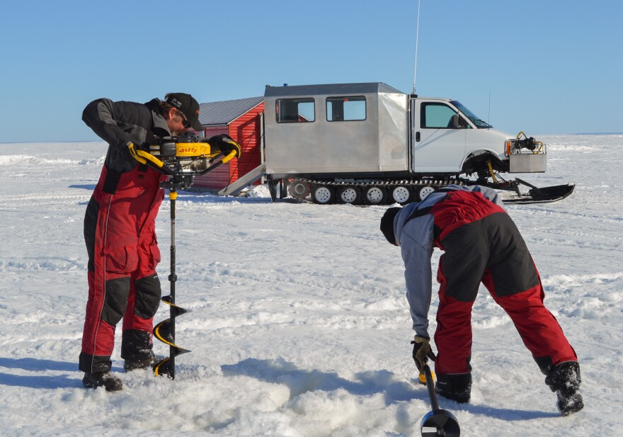 Anglers must drill holes into ice that's often more than two feet thick. They set up their fish houses over these holes.