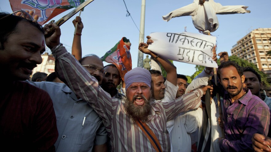 Supporters of India's main opposition Bharatiya Janata Party protest Tuesday in Allahabad, India, against the deaths of five Indian soldiers. India has accused Pakistani soldiers of firing across the Line of Control in Kashmir; Islamabad denies the charge.
