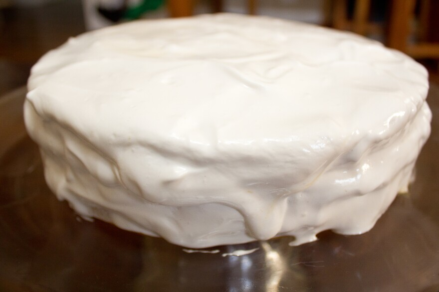 A Lane cake is a layered sponge cake filled with a rich mixture of egg yolks, butter, sugar, raisins and whiskey and topped with boiled icing.